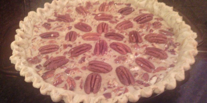 Place whole pecans on pie