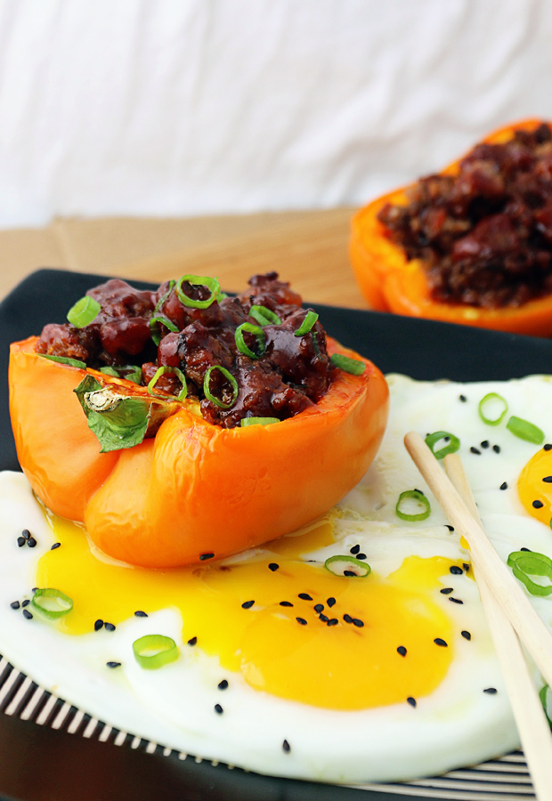 Get your Asian cravings taken care of with these Korean BBQ Beef Stuffed Bell Peppers! Shared via www.ruled.me/